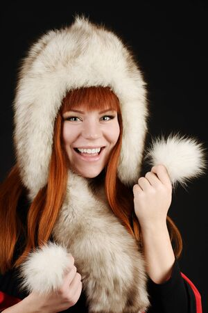happy redhead girl in fur photo
