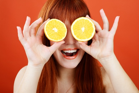 redhead girl with orange glasses photo