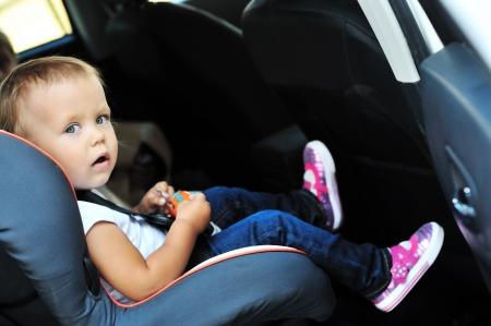 cute toddler girl in car seat Stock Photo