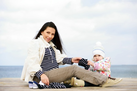 pregnant mother with daughter awaiting baby Stock Photo - 18063983