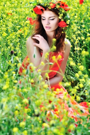 girl with crown from fieldd flowers photo