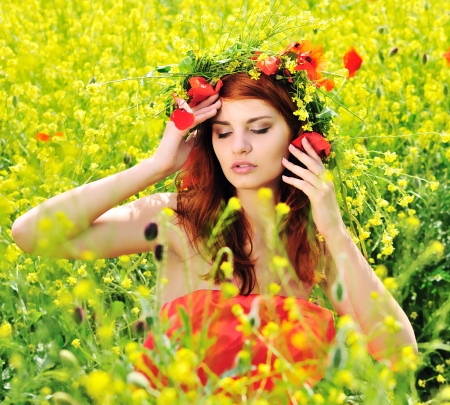 redhead girl with crown from field'd flowers photo