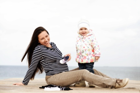 pregnant mother with daughter near the sea Stock Photo - 18064001