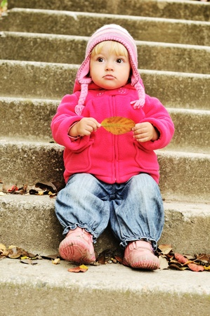 surprised toddler on the stairs photo