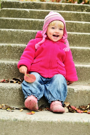 funny sweet toddler on the stairs photo