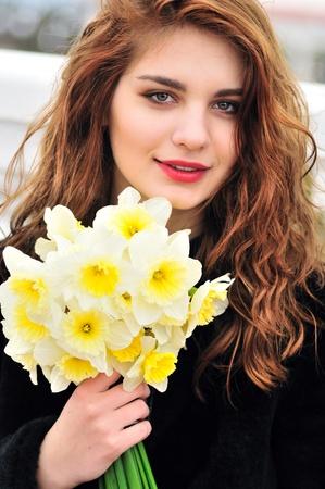 portrait of pretty girl with daffodils