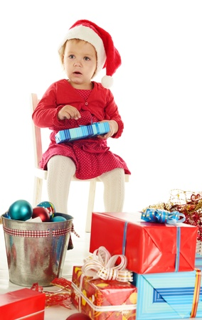 sad santa helper girl sitting on the chair Stock Photo - 18342298