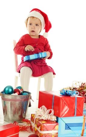 sad santa helper girl sitting on the chair Stock Photo - 18342298