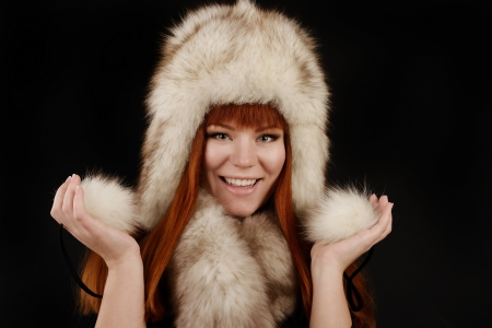 redheaded girl wearing fur hat photo