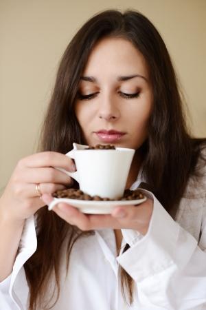 pretty brunette enjoying smell of coffee Stock Photo - 18342296