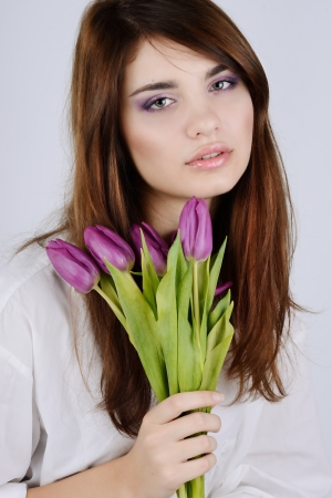 Beautiful tender girl with tulips photo