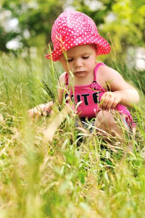 cute baby in grass in summer time photo