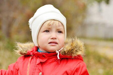 crying child: sad  sweet baby girl outdoors