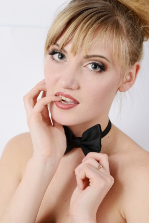 beauty pourtrait of young woman with bow tie photo