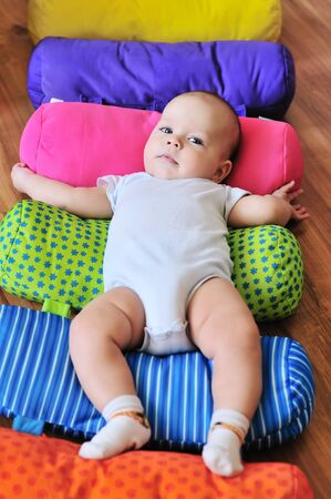 funny baby on the bright carpet Stock Photo - 18489351