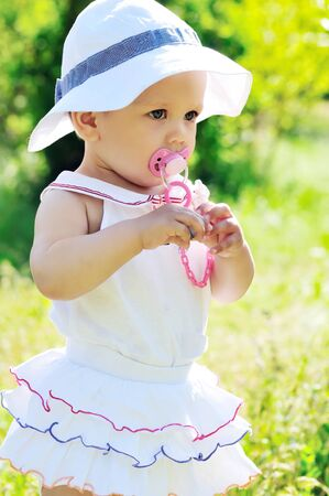 fashion summer baby with dummy photo