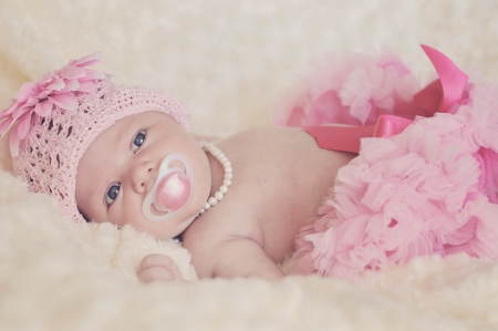 bed skirt: fashion newborn  girl wearing hat, pearl and skirt Stock Photo