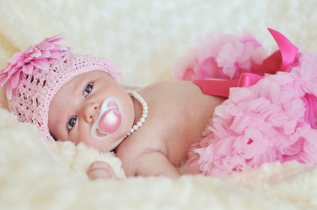 fashion newborn  girl wearing hat, pearl and skirt Stock Photo - 18489255