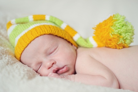 sleeping newborn wearing funny hat Stock Photo - 18530999