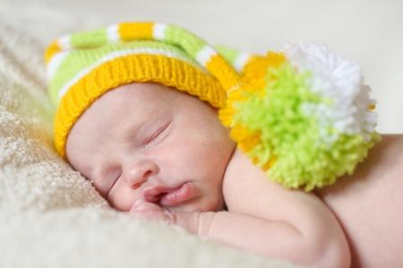 sleeping newborn wearing funny hat Stock Photo - 18530949