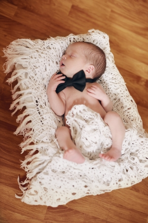 newborn boy wearing bow tie Stock Photo - 18530947