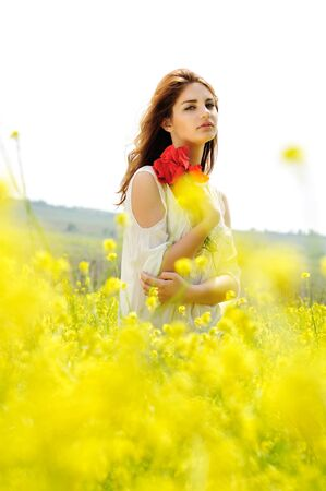young lady in blossom raps field Stock Photo - 18489218