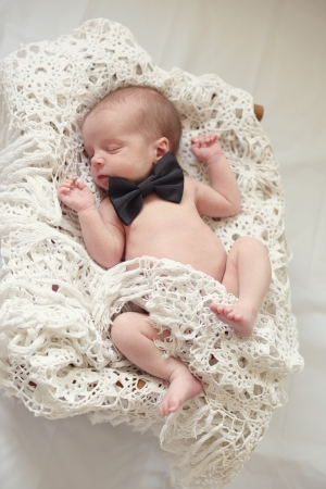 newborn gentleman in the basket photo