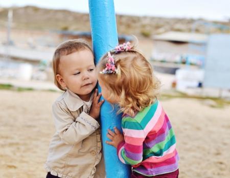 peekaboo: peek-a-boo, i see you - two playing girls Stock Photo