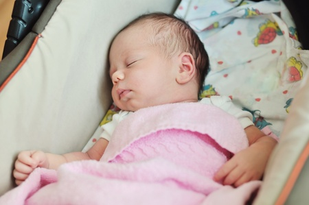 newborn sweet girl sleeping in pram photo