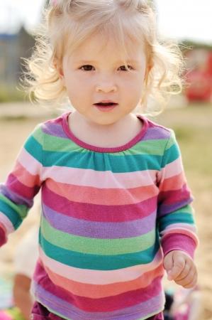 hazel eyes: toddler girl with hazel eyes Stock Photo