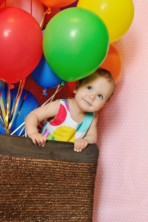 birthday one year old girl with baloons photo