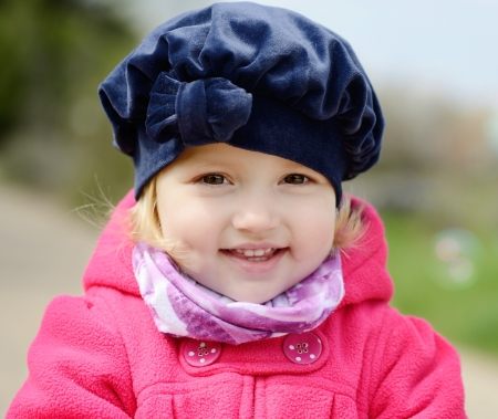 lovely toddler with sweet smile photo
