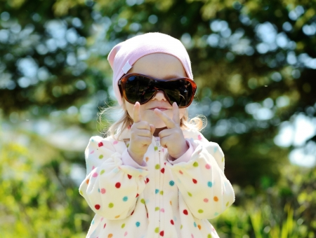 cute toddler girl wearing mother sunglasses photo