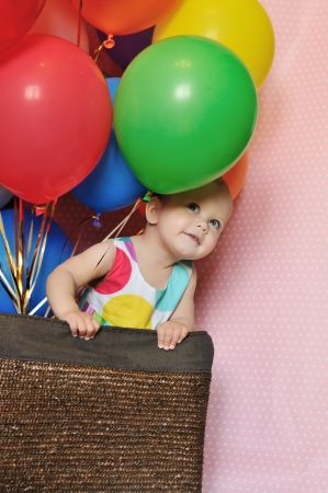 baby birthday party with balloons  photo