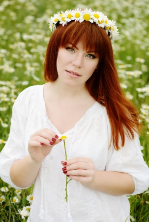 redhead girl with chamomile wreath Stock Photo - 22511835