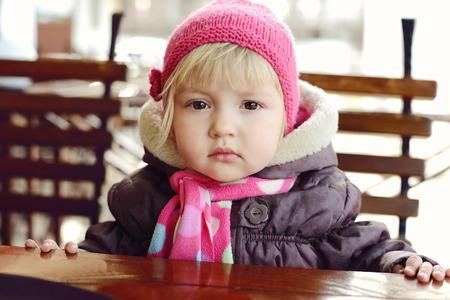 baby girl  in outdoor cafe photo
