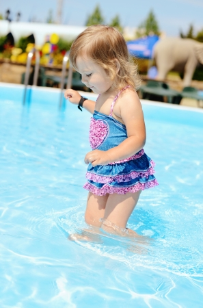 fashion toddler girl  in the pool photo
