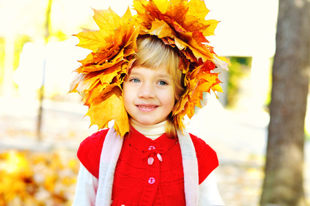 little girl wearing foliage wreath in fall time photo