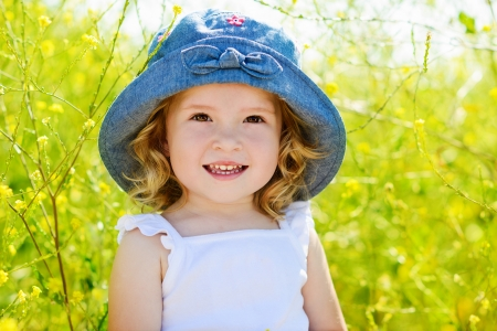happy toddler girl in rape seed field photo