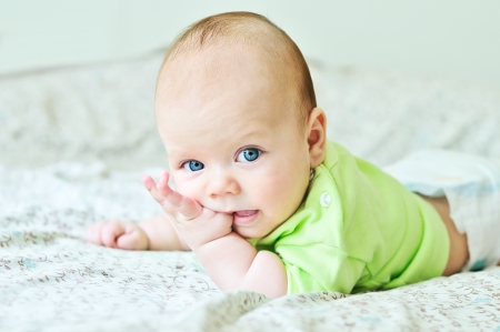 sweet baby with fingers in mouth Archivio Fotografico