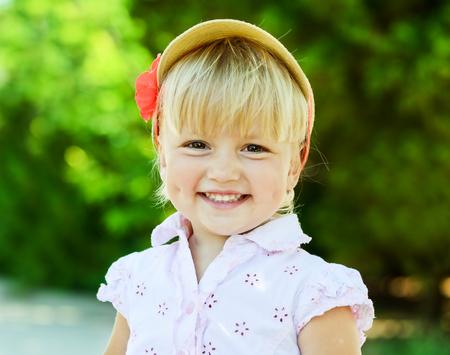 portrait of happy summer toddler girl photo