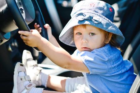 gearstick:   little girl  holding a car wheel Stock Photo