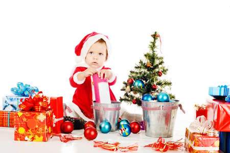 little Santa helper preparing for christmass photo