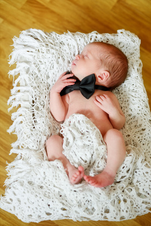 newborn boy wearing bow tie Stock Photo - 27455127