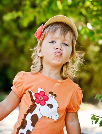 cute toddler girl making face photo