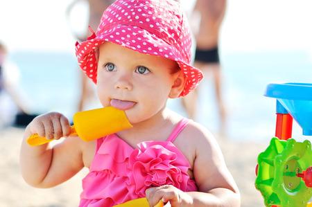 cute baby girl on the beach Stock Photo