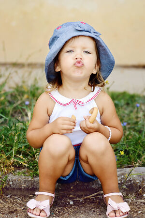 glamour toddler with funny duck face photo