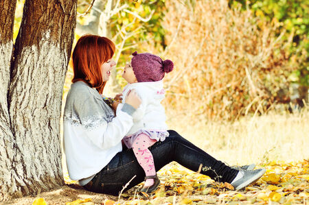 two sisters playing in fall park photo