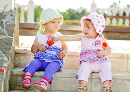 two baby friends sitting on the stairs photo