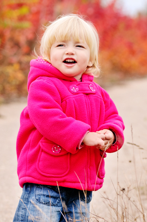 cute baby girl: cute toddler girl in fall park